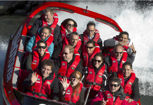 Britain's Prince William, center left, and his wife Kate, Duchess of Cambridge, center right, take a ride on the Shotover Jet boat near Queenstown, New Zealand, Sunday, April 13, 2014. The royal c