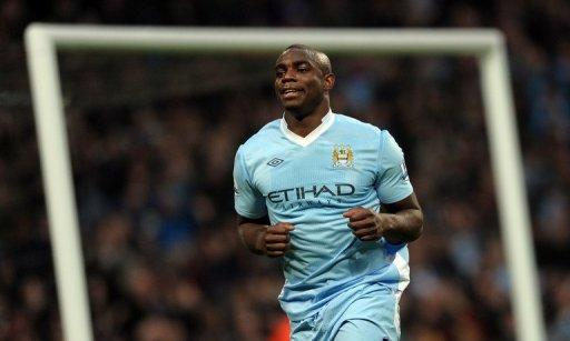 Micah Richards, pictured in 2011, will be sidelined for a month after suffering an ankle injury during the Olympics