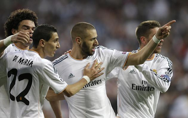 Real's Karim Benzema, center, celebrates scoring the opening goal during a  Champions League semifinal first leg soccer match between Real Madrid and Bayern Munich at the Santiago Bernabeu stadium
