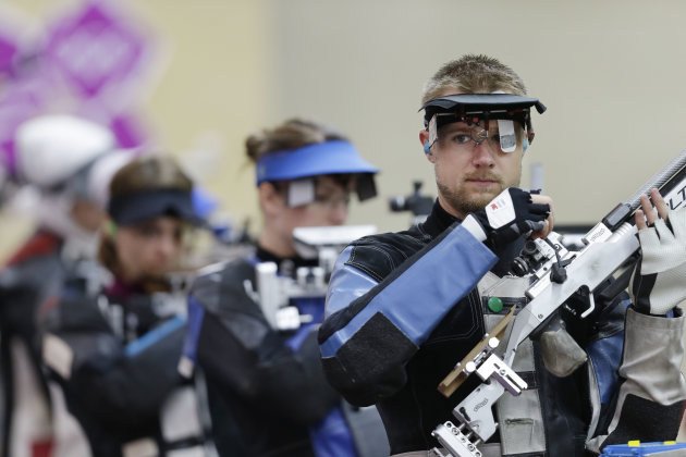 U.S. Olympic shooter Matt Emmons, right, is hardly a failure. (AP)