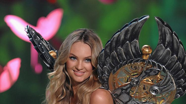 Model Candice Swanepoel  walks the runway during the 2009 Victoria's Secret fashion show at the Armory on November 19, 2009, in New York City.