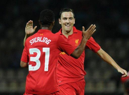 Stewart Downing (R) and Raheem Sterling of Liverpool celebrate scoring against Gomel