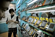 Fake iPhones are displayed in a shop at a market known for counterfeit goods in Shanghai. Italy's police said Saturday they have seized so far this year 52 million counterfeit items, including train tickets, smartphones, condoms and detergents, with much of them coming from China