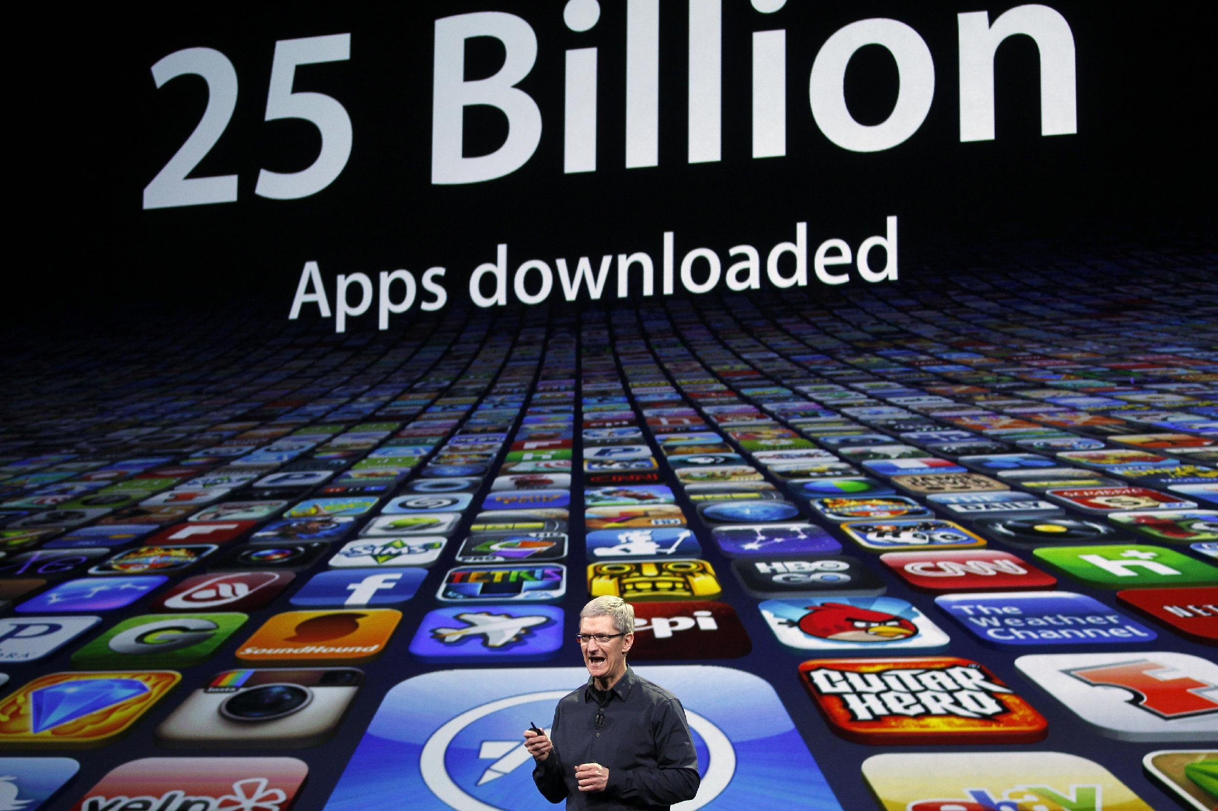 Apple CEO Tim Cook speaks about the number of Apps downloaded during an Apple event in San Francisco, California in this file photo from March 7, 2012. (Reuters)