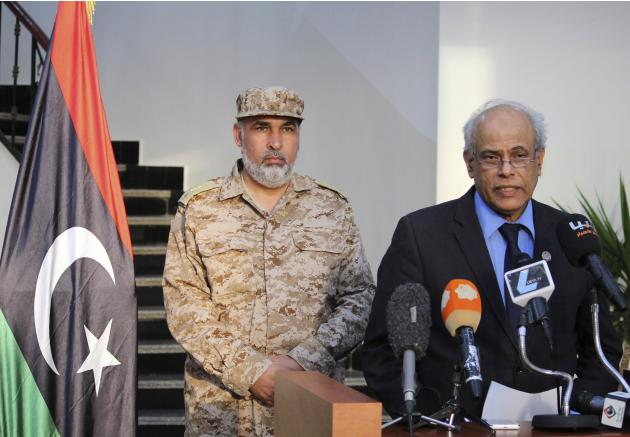 Libya's Justice Minister Salah al-Marghani speaks during a news conference in Benghazi