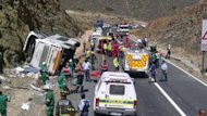 "The wreckage of a double-decker bus that has crashed in a mountain pass near Cape Town, killing 24 people. ""Twenty-three died on the scene and one person on the way to hospital,"" said Faiza Steyn, Western Cape health spokeswoman"