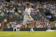 Britain's Andy Murray returns against Taiwan's Lu Yen-Hsun during their second round men's singles match on day three of the 2013 Wimbledon Championships tennis tournament at the All England Club in Wimbledon, southwest London, on June 26, 2013. Murray won 6-3, 6-3, 7-5