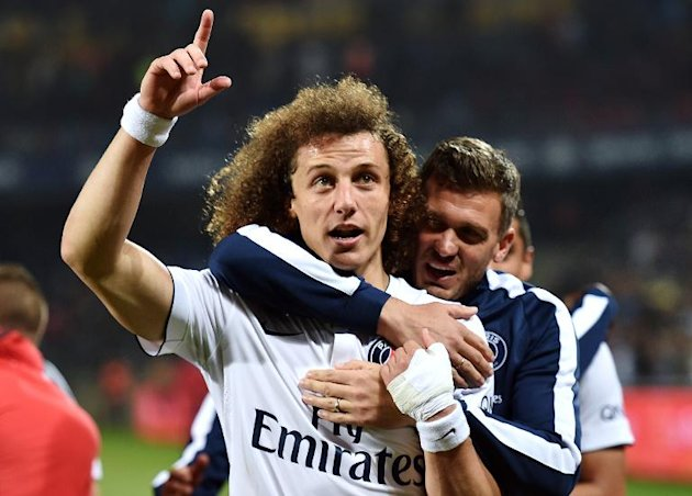 PSG's Brazilian defender David Luiz (L) celebrates with French goalkeeper Nicolas Douchez after securing their third successive Ligue 1 title on on May 16, 2015