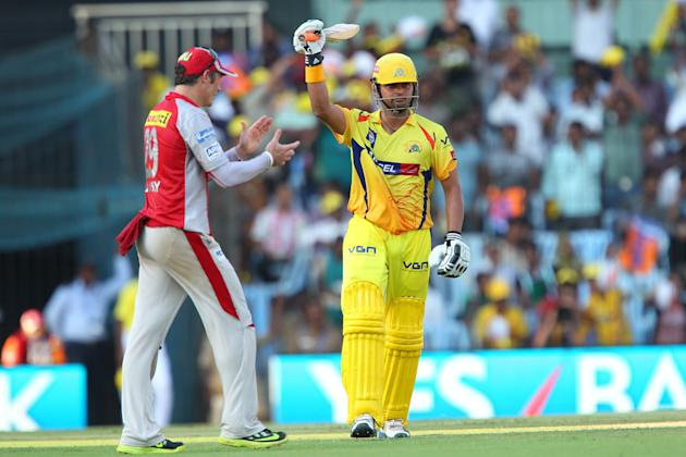 Suresh Raina celebrates his fifty as David Hussey congratulates him during match 45 of the Pepsi Indian Premier League between The Chennai Superkings and the Kings XI Punjab held at the MA Chidambaram