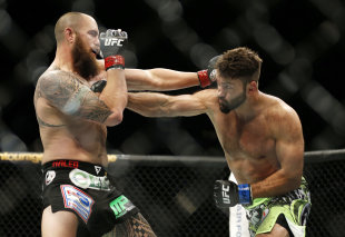 Andrei Arlovski (R) and Travis Browne trade blows at UFC 187. (AP)