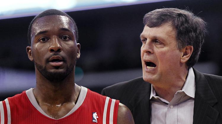 Houston Rockets head coach Kevin McHale talks to forward Jordan Hamilton in the second half of an NBA basketball game against the New Orleans Pelicans in New Orleans, Wednesday, April 16, 2014. The Pelicans won 105-100
