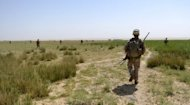 File photo of US soldiers on patrol with Afghanistan National Army (ANA) soldiers in Helmand Province, in June. An Afghan civilian employed on a NATO base shot dead three international coalition soldiers on Friday -- the same day three others were killed by an Afghan policeman, according to ISAF
