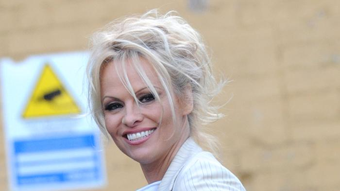 Pamela Anderson arrives at the Cambridge Union debating society at Cambridge University