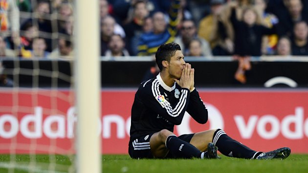 Cristiano Ronaldo (Real Madrid) sits on the turf disbelieving after the defeat against Valencia
