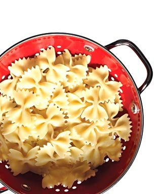 According to the author's mom, the great Marcella Hazan, colander should be sitting in the sink so the pasta can be drained the very instant it's cooked.