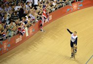 Great Britain's Chris Hoy celebrates after winning the Men's team sprint gold final as part of the track cycling event of London 2012 Olympic games, in London