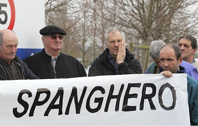 French farmers hold a placard as they demonstrate in support of the cooperative Lur Berri group, which includes Spanghero society, which is identified by French Consumer Affairs Minister Benoit Hamon