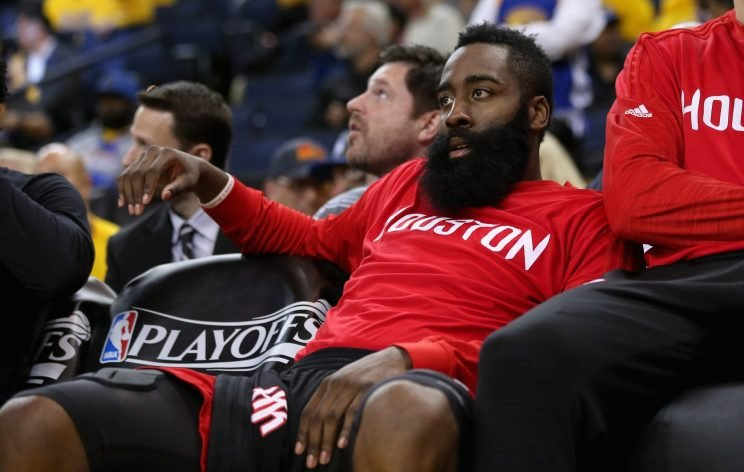 James Harden waits out the final Rockets game of last season. (Ezra Shaw/Getty Images)