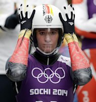 Natalie Geisenberger of Germany prepares to start her run during a training session for the women's singles luge at the 2014 Winter Olympics, Thursday, Feb. 6, 2014, in Krasnaya Polyana, Russia. (AP Photo/Michael Sohn)