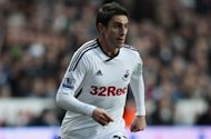 Rangel urges Swansea to maintain composure in Cardiff clash