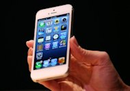 Made of glass and aluminum, the new iPhone 5 features a new design to nestle in one's palm to naturally align with thumbs and works on the faster mobile Internet networks known as LTE