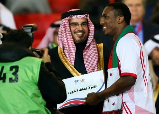Emarati player Ahmad Khalil (R) receives the best scorer diploma for the 21st Gulf Cup from Bahraini Crown Prince Salman bin Hamad bin Isa Al Khalifa at the end of the Cup's final on January 18, 2013