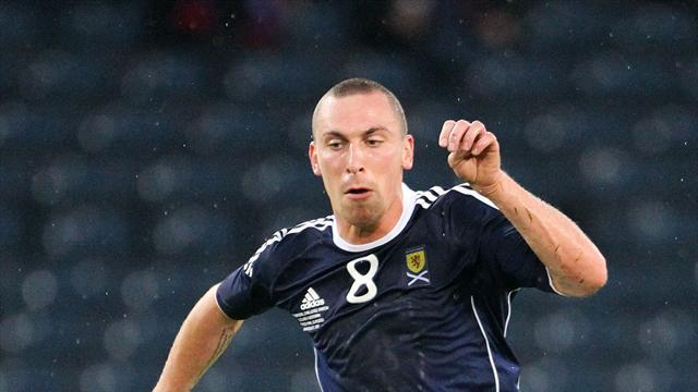 Football - Brown eager to skipper Scots again