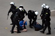 "Polish anti-riot policemen detain Poland's football fans after tension posed the city's ""greatest ever"" security challenge in Warsaw. Police used an arsenal of tear gas, water cannon, rubber bullets and pepper spray and detained dozens of brawling football fans ahead of a key Euro 2012 match between Poland and Russia on Tuesday"