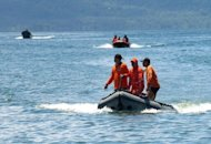 This file photo shows coastguard rescue team searching for survivors after an accident off southern island of Mindanao, on August 26, 2008. Fishermen and rescue workers hauled dozens of people out of the ocean after a ferry sank in the central Philippines on Friday, but at least two passengers drowned and 13 others were missing, authorities said