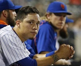 Wilmer Flores was thought to have been traded to the Brewers but will remain a Met. (AP)