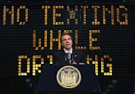 New York Governor Andrew Cuomo announces a bill with tougher penalties for texting while driving at a press conference on May 31, 2013 in New York City. Under the law signed by Cuomo, drivers under the age of 18 will have their licenses suspended for a first offense of sending SMS messages while driving