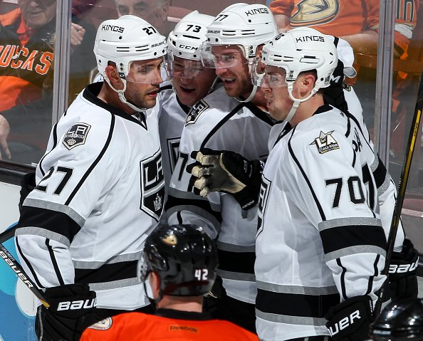 ANAHEIM, CA - NOVEMBER 20: Jeff Carter #77 of the Los Angeles Kings celebrates his second-period goal with Alec Martinez #27, Tyler Toffoli #73 and Tanner Pearson #70 during the game against the Anaheim Ducks at Honda Center on November 20, 2016 in Anaheim, California. (Photo by Debora Robinson/NHLI via Getty Images)