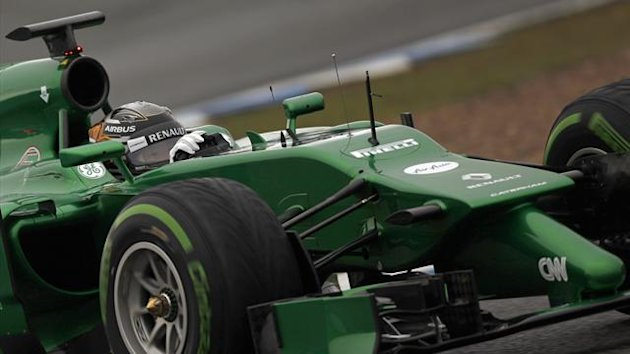 Caterham Formula One driver Kamui Kobayashi of Japan drives his car during pre-season testing at the Jerez racetrack in southern Spain January 31, 2014 (Reuters)