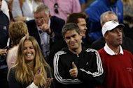 "The faces of Andy Murray's girlfriend Kim Sears (left) and physiotherapist Andy Ireland (centre) break into smiles as he wins the US Open in New York on September 9 -- but the stoic countenance of coach Ivan Lendl (right) barely cracks despite his pupil's emotional victory. ""That's almost a smile for him,"" Murray said as the crowd roared in delight"