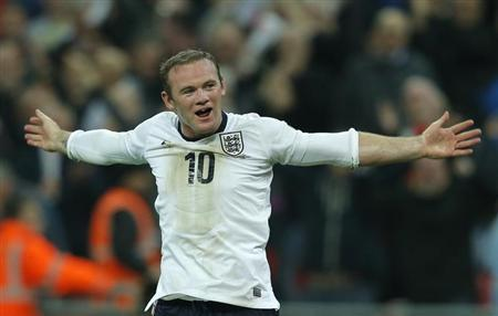 England's Wayne Rooney celebrates after scoring during their 2014 World Cup qualifying soccer match against Poland at Wembley Stadium in London