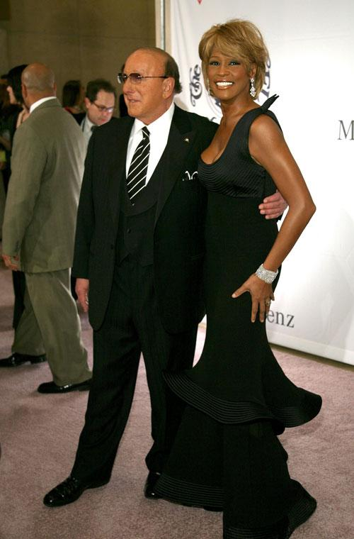 OCTOBER 28: Producer Clive Davis (L) and singer Whitney Houston arrive at the 17th Annual Mercedes-Benz Carousel of Hope Ball at the Beverly Hilton Hotel on October 28, 2006 in Beverly Hills, California. (Photo by Michael Buckner/Getty Images)