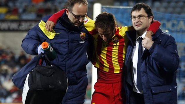 Barcelona's Neymar (C) is helped off the pitch after getting injured during the Copa Del Rey win over Getafe (Reuters)