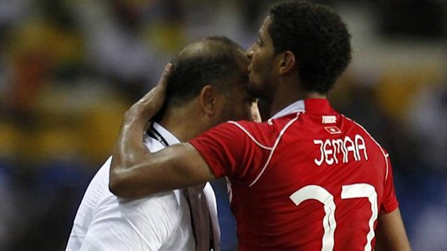 Tunisia's Issam kisses his coach Samir Trabelssi as he celebrates his goal (Reuters)