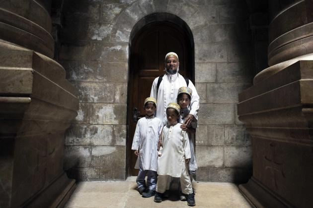 The Lovai family from India pose for a photograph in the Church of the Holy Sepulchre in Jerusalem's Old City