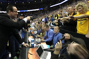 Gregg Marshall celebrates with a fan after beating Kansas in the NCAA tournament Round of 32. (Getty)