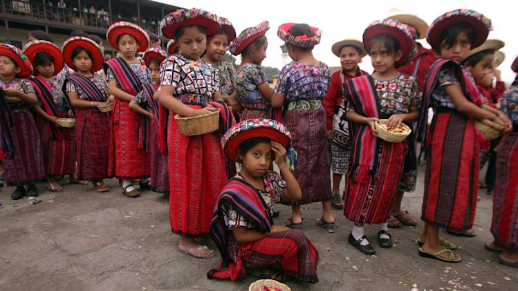 Indigenous Mayan children prepare for memorial service in honor of Father Stanley Rother in Santiago Atitlan