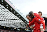 Manchester United's English forward Wayne Rooney (L) is congratulated after scoring a penalty during an English Premier League football match between Manchester United and Aston Villa at Old Trafford in Manchester. United won 4-0