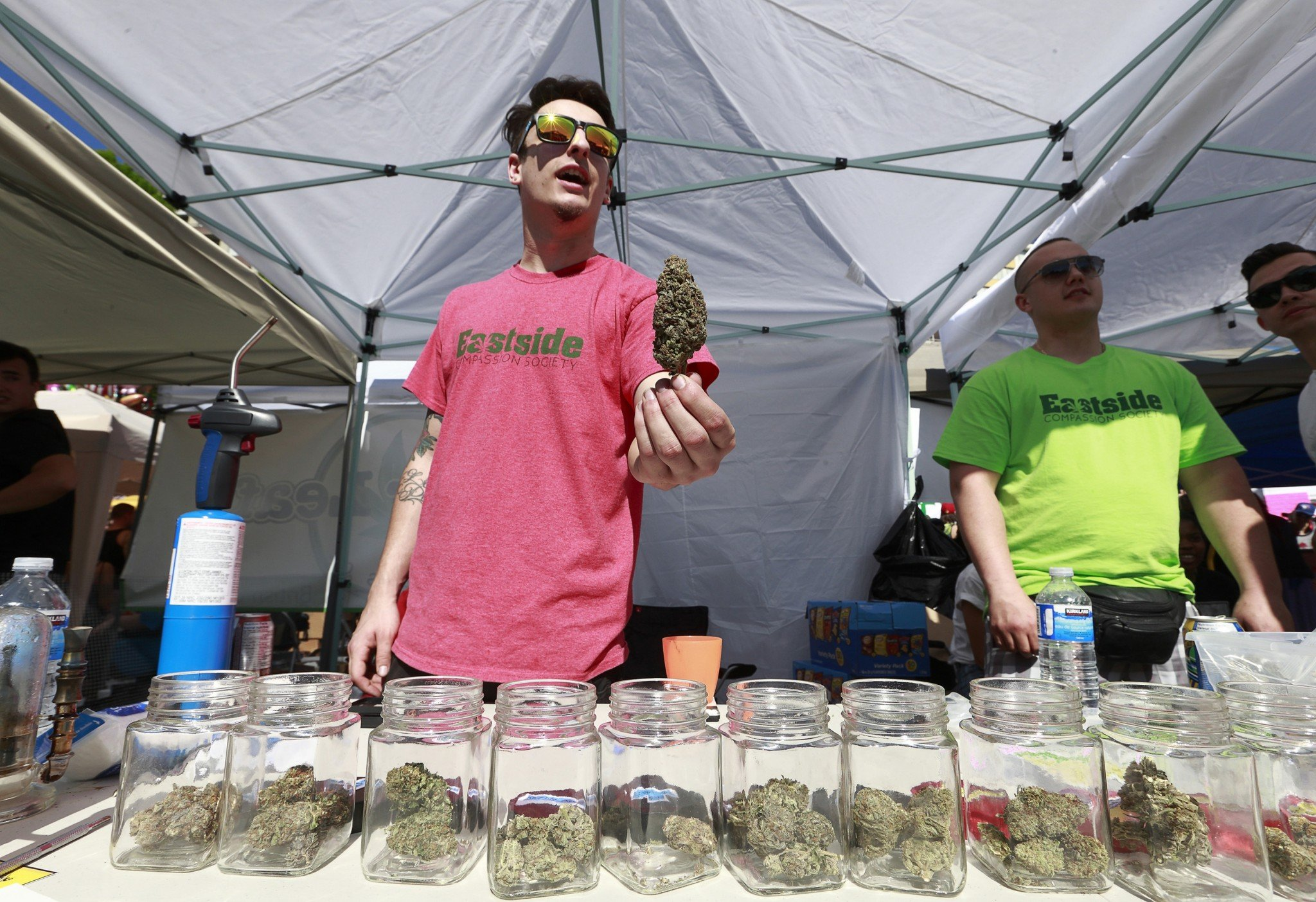 A vendor sells pot as thousands of people gather at 4/20 celebrations on April 20, 2016 at Sunset Beach in Vancouver, Canada. (Getty)