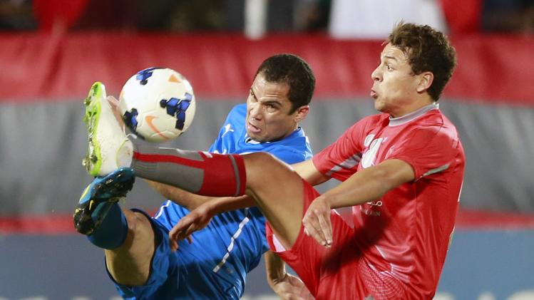 Msakni of Qatar's Lekhwiya fights for the ball with Juliano Bahrain's Al-Hidd during their AFC Champions League match in Doha