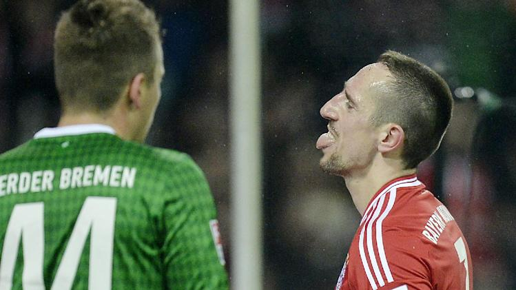 Bayern's three-times scorer Franck Ribery of France, right, stands  beside Bremen's Philipp Bargfrede during the German Bundesliga soccer match between Werder Bremen and Bayern Munich in Bremen, Germany, Saturday, Dec. 7, 2013. Bayern defeated Bremen by 7-0