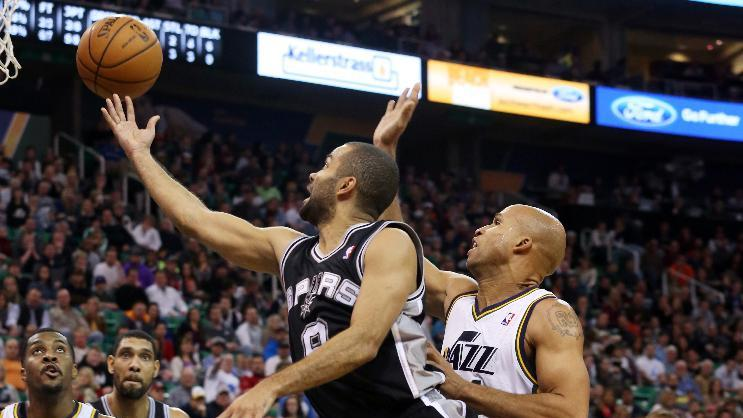San Antonio Spurs' guard Tony Parker, front left, shoots the ball as Utah Jazz's forward Richard Jefferson, right, defends in the first half of an NBA basketball game on Saturday, Dec. 14, 2013, in Salt Lake City