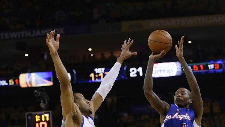 Los Angeles Clippers' Jamal Crawford, right, makes a 3-point basket over Golden State Warriors' Andre Iguodala during the first half in Game 3 of an opening-round NBA basketball playoff series Thursday, April 24, 2014, in Oakland, Calif
