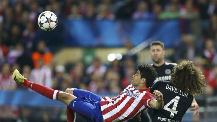 Atletico Madrid's Diego Costa lines up an overhead kick next to Chelsea's David Luiz during their Champion's League semi-final first leg soccer match at Vicente Calderon stadium in Madrid