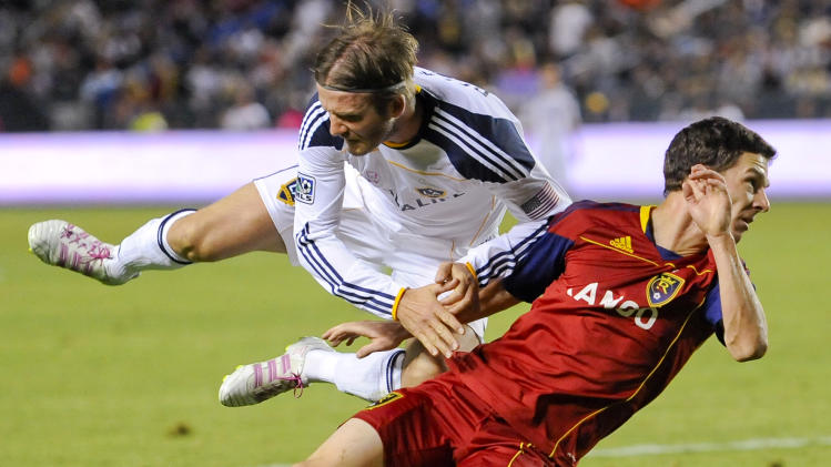 Los Angeles Galaxy midfielder David Beckham, left, of England, and Real Salt Lake midfielder Will Johnson, right, collide during second half of an MLS soccer match, Saturday, Oct. 1, 2011, in Carson, Calif. The Galaxy won 2-1. (AP Photo/Gus Ruelas)