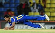 Sri Lankan cricketer Thisara Perera takes a catch to dismiss Pakistan cricketer Mohammad Hafeez during the second one-day international (ODI) match between Sri Lanka and Pakistan in Pallekele. Sri Lanka posted an easy 76-run win over Pakistan